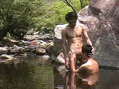 Asian twinks sucking and fucking in mountain river