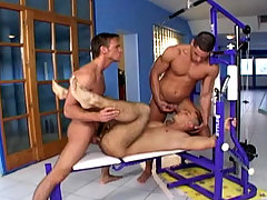 Three handsome muscle studs having a threesome at the gym