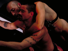Justin Southhall works over Scott Samson in a down-n-nasty S&M scenario worthy of de Sade himself. Scott, in bondage among two pillars, moans like
